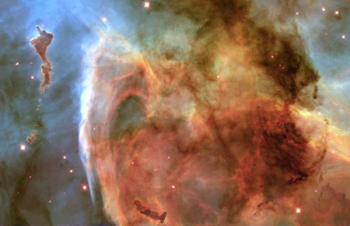 hubble-best-photos-light-shadow-carina-nebula